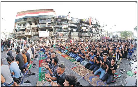 sunni and shiite muslims perform eid prayers at the site
